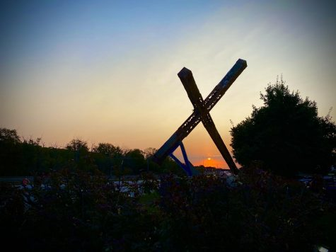 Sunrise and the Leaning Cross